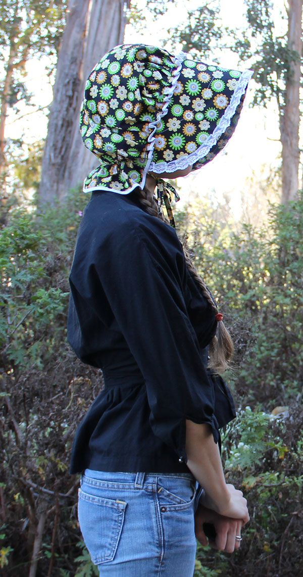 Wearing the sunbonnet, side view